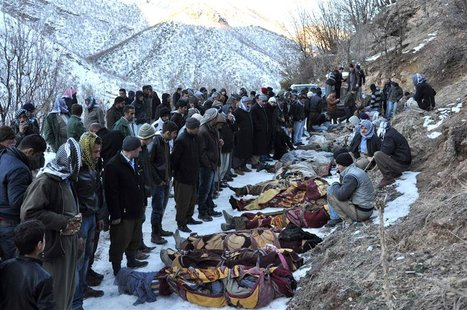 Locals gather around bodies of people who were killed in air strikes in Ortasu village near the southeastern Turkish town of Sirnak