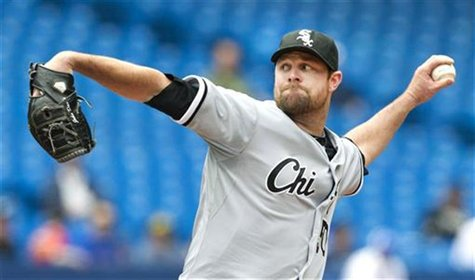 Chicago White Sox pitcher John Danks throws against the Toronto Blue Jays in Toronto.