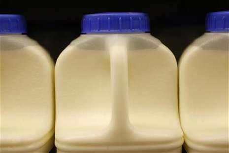 Milk containers are seen in a shop in Basildon, southeast England