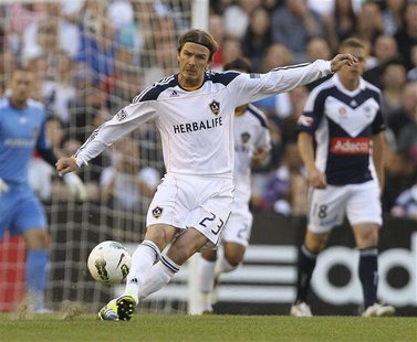 LA Galaxy's David Beckham of England passes the ball during their friendly match against Melbourne Victory