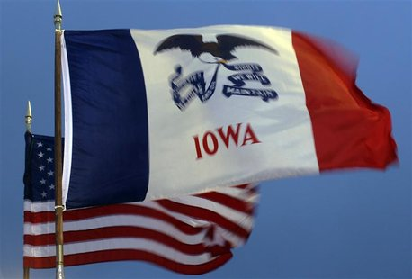 The U.S. and Iowa state flags fly at a rally with Republican presidential candidate and former Massachusetts Governor Romney in West Des Moi
