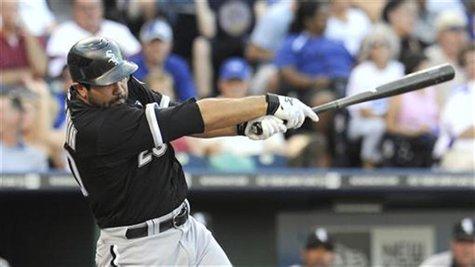 White Sox' Quentin singles to score Pierre against the Royals during their MLB American League baseball game in Kansas City