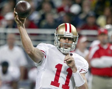 San Francisco 49ers quarterback Alex Smith throws a pass during the first half of their NFL football game against the St. Louis Rams in St.