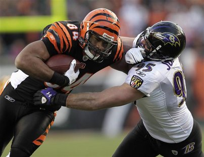 Cincinnati Bengals tight end Jermain Gresham is tackled by Baltimore Ravens' Jarret Johnson (during the first half of play in their NFL foot