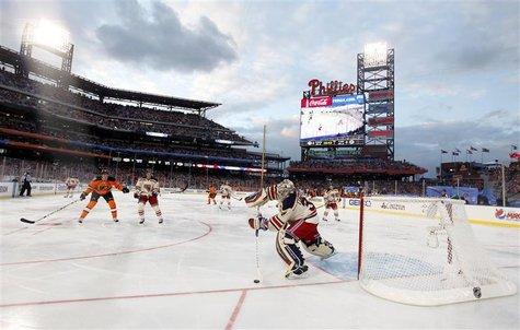 New York Rangers goalie Henrik Lundqvist plays the puck against the Philadelphia Flyers during the second period in the NHL Winter Classic h