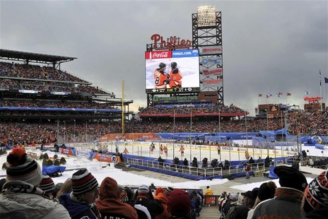 Spectators watch the Philadelphia Flyers and the New York Rangers play the NHL Winter Classic hockey game in Philadelphia