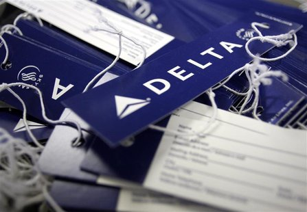 Delta airline name tags are seen at Delta terminal in JFK Airport in New York