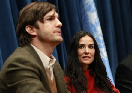 Actor Kutcher speaks as his wife actress Moore looks on during a conference at the United Nations Headquarters in New York