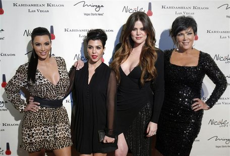 Television personalities Kim Kardashian, Kourtney Kardashian, Khloe Kardashian and Kris Jenner arrive at the grand opening of the Kardashian