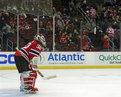 Fans near Devils goalie Brodeur leave the arena in the third period of their NHL hockey game in Newark.