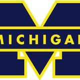 The Michigan Wolverines logo is shown in a stock image.