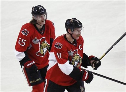 Senators' Alfredsson skates with teammate Karlsson after scoring a goal against the Panthers during their NHL hockey game in Ottawa
