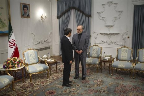 Iran's FM Salehi speaks with Iranian President Ahmadinejad before official meeting with Turkey's FM Davutoglu in Tehran