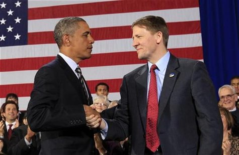 U.S. President Obama shakes hands with Cordray during trip to Cleveland