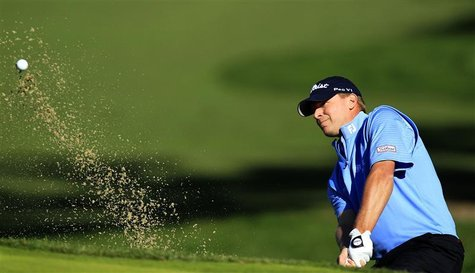 Steve Stricker hits out of a bunker of the fifth hole during the first round of the Chevron World Challenge PGA golf tournament in Thousand