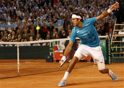 Argentina's Del Potro returns the ball to Spain's Nadal in Seville