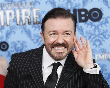 "Ricky Gervais gestures during a photo call for the premiere of the second season of ""Boardwalk Empire"" in New York"