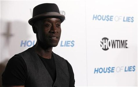 "Cheadle poses at the premiere for the television series ""House of Lies"" in Los Angeles"