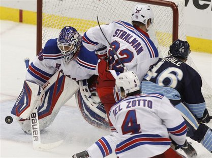 New York Rangers goalie Henrik Lundqvist blocks a shot by the Pittsburgh Penguins in the third period.