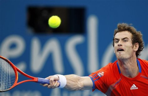 Murray of Britain hits a return to Dolgopolov of Ukraine during their men's final match at the Brisbane International tennis tournament
