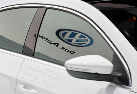 The Volkwagen logo is seen reflected on the window of the newly-designed 2013 Volkswagen CC at the LA Auto Show in Los Angeles
