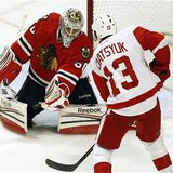 Chicago Blackhawks' goalie Crawford makes a save off Detroit Red Wings' Datsyuk during their NHL hockey game in Chicago