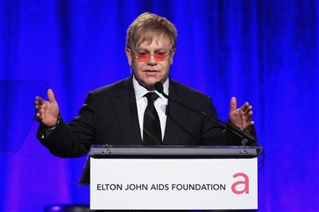 Singer Elton John speaks during a benefit for the Elton John AIDS Foundation in New York