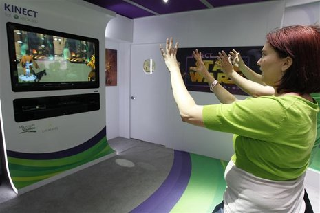 Liz Miller of Los Angeles plays Kinect for Star Wars at the Microsoft XBOX 360 booth at E3 in Los Angeles