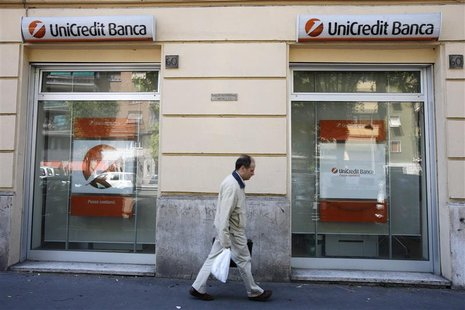 A man walks past the entrance to a Unicredit bank office in Rome