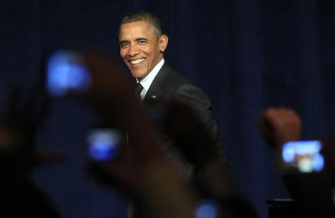 U.S. President Barack Obama smiles as he arrives on stage to speak at a campaign event in Washington