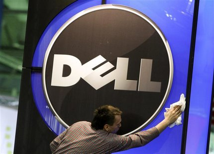 A man wipes logo of Dell IT firm at CeBIT exhibition centre in Hannover