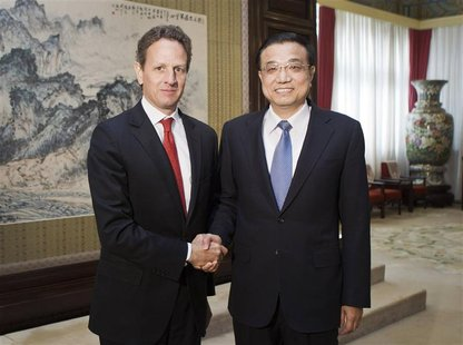 U.S. Treasury Secretary Geithner shakes hands with Chinese VP Li in Beijing