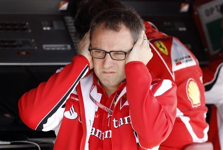 Ferrari Formula One team principal Domenicali reacts in the pit during the third practice session of the Hungarian F1 Grand Prix at the Hung
