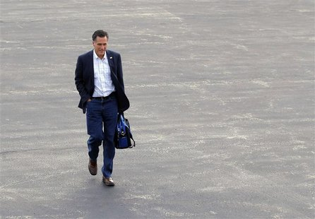 Republican presidential candidate and former Massachusetts Governor Mitt Romney walks across the tarmac to his campaign plane in Bedford