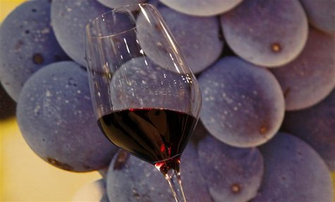 A glass of red wine is displayed at Vinitaly wine expo in Verona
