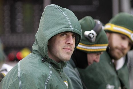 Green Bay Packers quarterback Rodgers looks on from the bench as the Packers take on the Detroit Lions during the second half of their NFL f