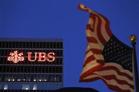An U.S. flag flies in front of a UBS building in New York
