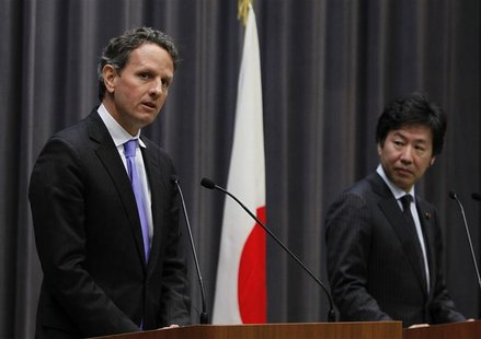U.S. Treasury Secretary Geithner speaks next to Japan's Finance Minister Azumi during their joint news conference at the Finance Ministry in