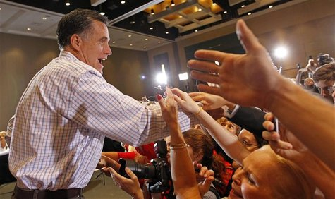Republican presidential candidate and former Massachusetts Governor Mitt Romney greets supporters during a campaign rally in West Palm Beach