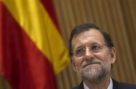 Spanish Prime Minister Mariano Rajoy gestures during a meeting with the People's Party parliament members in Madrid