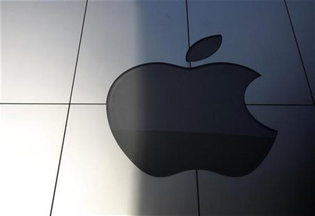 An Apple logo is seen with its light switched off at an Apple store in Tokyo