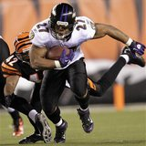 Baltimore Ravens running back Ray Rice fights to break free from Cincinnati Bengals' Chris Crocker uring the first half of play in their NFL