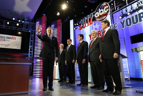Republican presidential candidates pose before a Republican presidential debate at St. Anselm College in Manchester