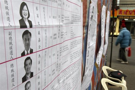 The list of presidential and vice presidential candidates are seen on a board at a polling station during Taiwan presidential and legislativ