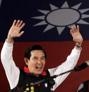 Taiwan President and Nationalist Party (KMT) presidential candidate Ma Ying-jeou celebrates after provisional election results of the Taiwan