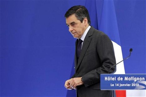 France's Prime Minister Francois Fillon delivers a speech as he attends a news conference at the Hotel Matignon in Paris