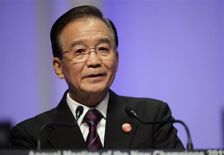 File photo shows China's Premier Wen Jiabao delivers a speech at the opening ceremony of WEF meeting in Dalian