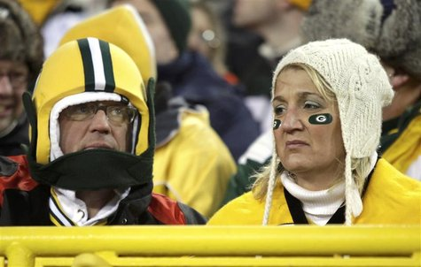 Green Bay Packers fans watch their team play the New York Giants in the fourth quarter during their NFL NFC Divisional playoff football game