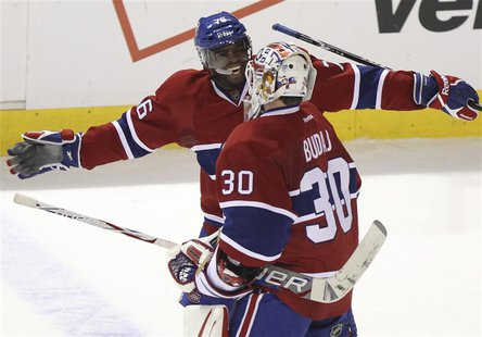 Canadiens goalie Budaj is congratulated on win over Rangers by teammate Subban following third period NHL hockey action in Montreal