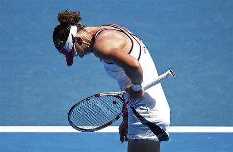 Stosur of Australia reacts after losing a point to Cirstea of Romania during their women's singles match at the Australian Open tennis tourn